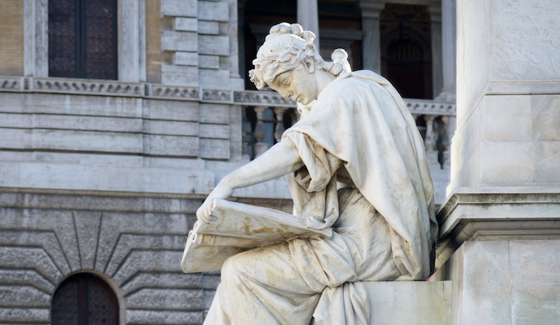 woman reading statue